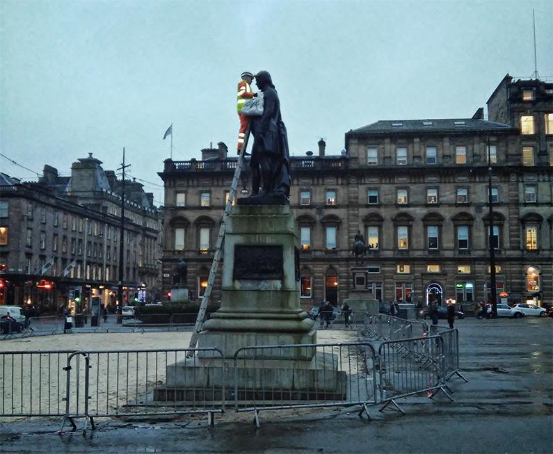 Robert Burns. Statue in George Square getting a clean.